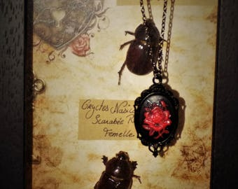 Black cabochon necklace in red resin rose