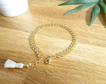 Spike chain bracelet gold and white tassel