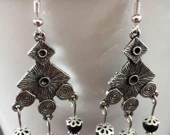 Pretty earrings with 3 dark blue beads