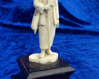 Carved late 19th early 20th century ivory figure of clan or tribal leader
