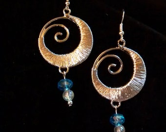 Round silver dangling earrings with blue Swarovski crystals