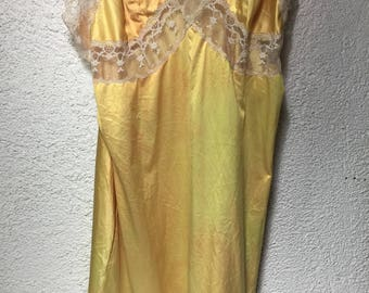 Shortened yellow slip with white lace accents