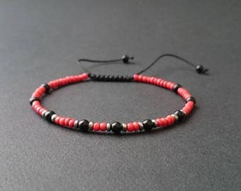 Man in red coral beads and onyx and hematite stones bracelet
