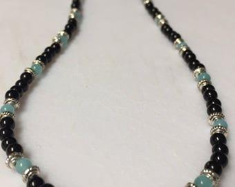 Light blue cats eye and black glass neckace
