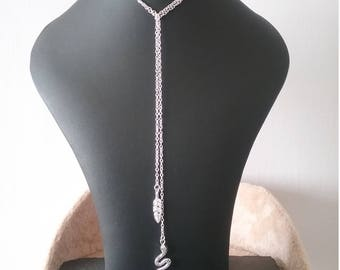 Silver necklace, lariat necklace with leaf and snake charms.
