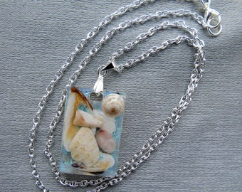 Crystal resin pendant with seashells collected from Scottish beaches with a silver bail and chain