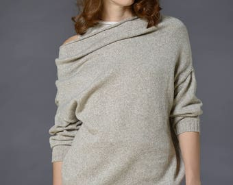 Extravagant over size ladies pullover knitted of 100% wool yarn