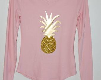Pink long sleeve blouse with golden vinyl pineapple design and golden vinyl glitter