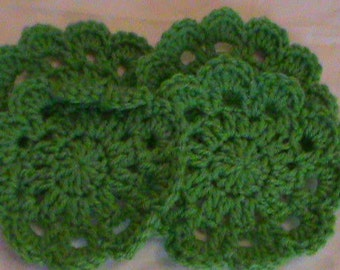 Crocheted green coaster set (4) with plastic bottom