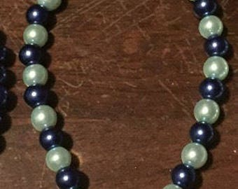 "7"" Blue and mint beaded bracelet with silver hand charm"