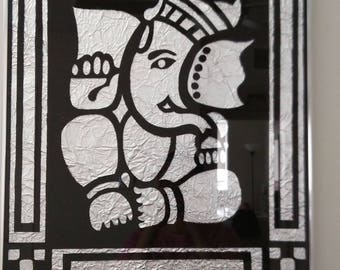 Ganesh on clear glass with aluminum foil background
