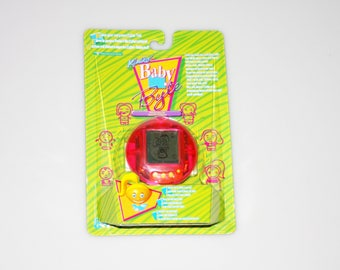 Kimiko Baby Byte Tamagotchi Pet Style Virtual Cyber Tot DEADSTOCK Factory Sealed Trendmasters Vintage 1997