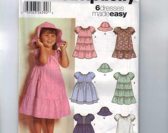 1990s Girls Sewing Pattern Simplicity 5695 Girls Tiered Ruffled Skirt Sun Hat Size 2 3 4 Breast 21 22 23 UNCUT
