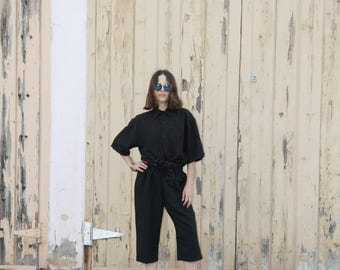 Black loose cropped pants. S