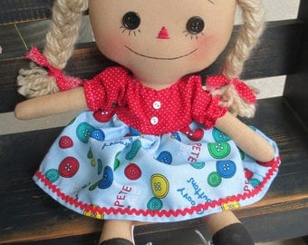 "Raggedy Annie with cat ""pete"" and button print apron"