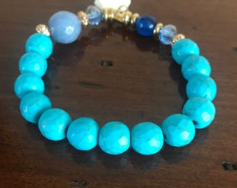 Lucky turquoise beaded stretch bracelet with elephant charm