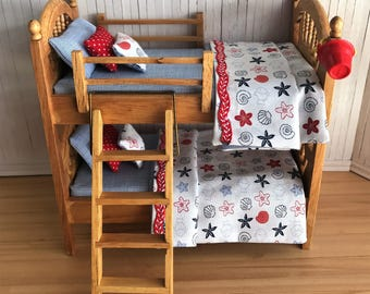 Miniature Nautical Wood Bunk Beds With Adorable Beach Bedding Sets And Throw Pillows, A Wood Ladder, And Red Beach Pail