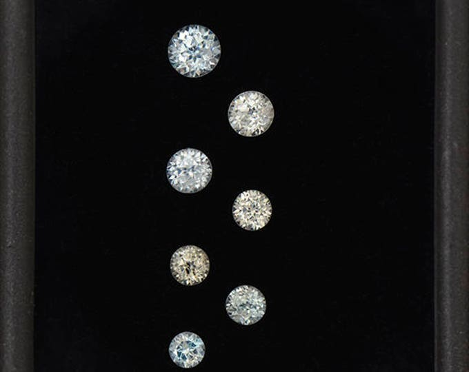 UPRISING SALE! Icy Blue and White Zircon Gemstone Set from Cambodia 1.60 tcw.