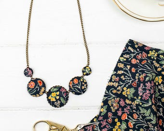 Botanical Liberty print fabric button necklace in Black, Mustard, Orange and Crimson