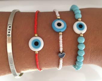 Evil eye friendship bracelet.Seed bead jewellery.Hematite, sterling silver and gold filled bead bracelet