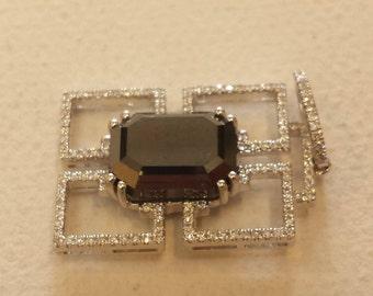 18 K white gold black diamond and white diamond pendant