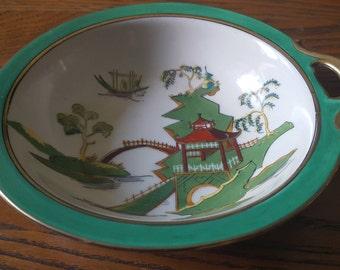 Noritaki, red M, handle bowl,Pagoda scene.