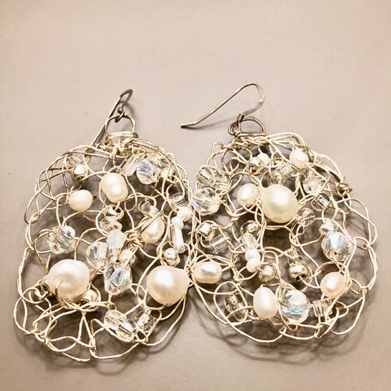 Handmade sterling silver wire crochet earrings with pearls, crystal, moon stones and glass beads.