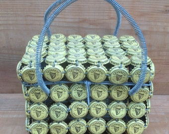 Hand bag with iron structure and guiness capsules.