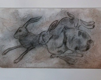 Original dry point etching: Running hares. Hand-coloured etching.
