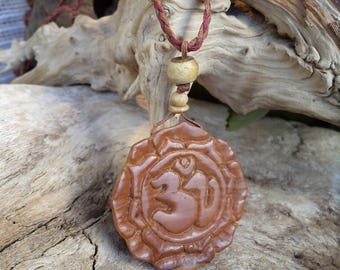 Omkar in Lotus.Olive wood pendant