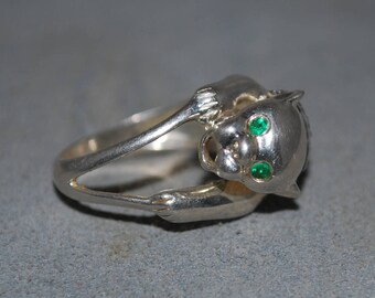 Sterling silver ring size 6.75 panther figure with emerald eyes and zircon encrusted collar.
