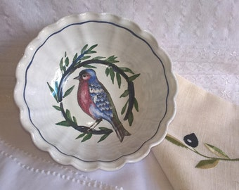 Hand painted Mediterranean pottery bowl, possibly a jelly mould. Painted with a bird on an olive branch. Integral hanger at the back.