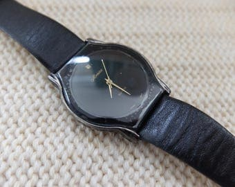 Minimal black 1980s Moniex watch with rhinestone and black leather band