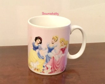 Coffee Mug Cup Holds 1.5 Cups Disney Princesses Snow White Cinderella Sleeping Beauty / Castle on side Reads Princess on Back By Gibson