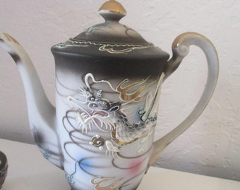 16 pieces of Kutani Dragonware, including 7 inch teapot, hand painted with raised dragon lithophane