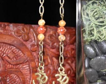 handmade Om dangle earrings
