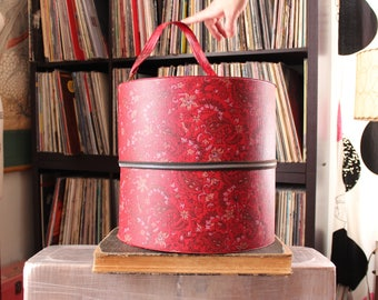large vintage wig box, round red vinyl train case luggage . floral 1960s 70s zipper case hat box