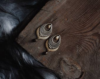 rhapsody. a pair of bohemian brass teardrop and tiny bell earrings.