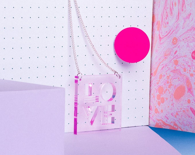 Unique pink LOVE typographic statement necklace made from transparent acrylic