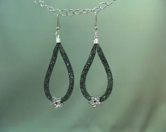 earring in black FishNet tube