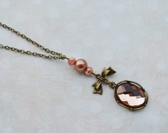 Nude necklace and bronze faceted glass cabochon