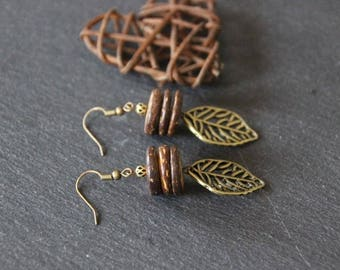 Ethnic style earrings, Brown coconut slices, bronze leaf charm