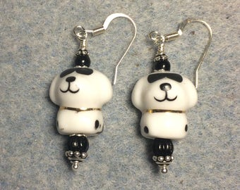 Black and white ceramic puppy dog (wearing sunglasses) dangle earrings adorned with black Czech glass beads.