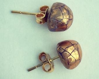 Gold porcelain ear studs. Ceramic gold ear studs. Gold ear studs.