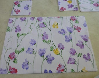 Placemats & coasters.  Set of 4. Pretty Flowers Print.  Sturdy cotton fabric.   Fully washable.   Pretty, fun and practical.