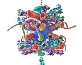 The Wiz an enchanting shredder bird toy for medium sized birds