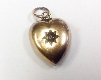 Antique, Victorian, 9 ct gold, gem set, puffy heart pendant.