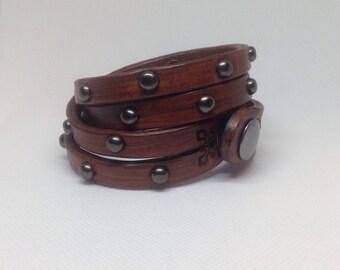 Brown split wrap bracelet with spots.