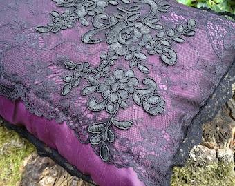 Pillow features Gothic romantic Black Lace on purple background