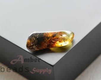 Baltic amber stone. Natural amber piece. Green amber color. Polished amber. 2520/6